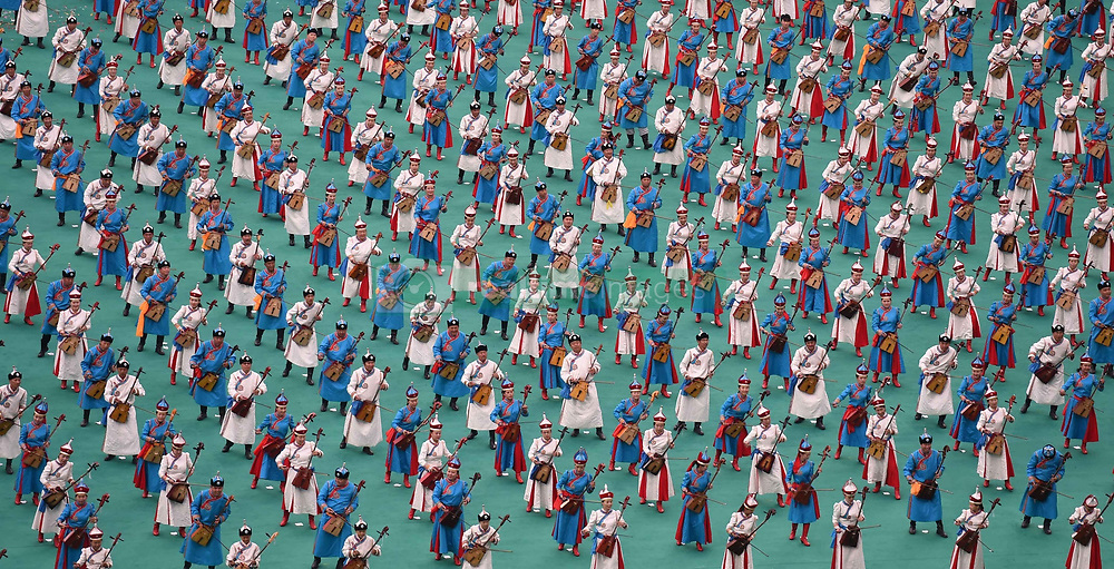 ORDOS, Aug 9, 2015  Hundreds of performers play horse head string instrument, a traditional Mongolian musical instrument, at the opening ceremony of the 10th National Traditional Games of Ethnic Minorities of China in Ordos, north China's Inner Mongolia Autonomous Region, Aug. 9, 2015. (Xinhua/Lin Yiguang) (Credit Image: © Xinhua via ZUMA Wire)