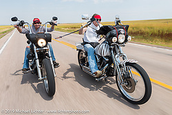 Riding to the Spur Creek Ranch on the annual Michael Lichter - Sugar Bear Ride hosted by Jay Allen with the Easyriders Saloon during the Sturgis Black Hills Motorcycle Rally. SD, USA. Sunday, August 3, 2014. Photography ©2014 Michael Lichter.