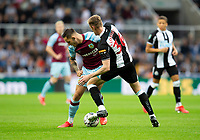 Football - 2021 / 2022  EFL Carabao Cup - Round Two - Newcastle United vs Burnley - St Jame's Park - Wednesday 25th August 2021<br /> <br /> Josh Brownhill of Burnley vies with Sean Longstaff of Newcastle United<br /> <br /> Credit: COLORSPORT/Bruce White