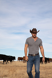 cowboy walking on a cattle ranch