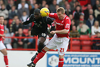 Photo: Pete Lorence.<br />Nottingham Forest v Bentford. Coca Cola League 1. 04/11/2006.<br />Jo Kuffour and John Curtis battle for the ball.