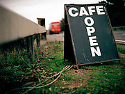 A roadside cafe sign advertising Dona's Cafe along the busy A12 trunk road on the 20th October 2009 in Stratford St Mary in the United Kingdom.