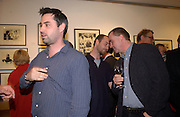 Alex Garland ( Theo Garland behind)  and Tim Garland. Nicholas Garland prints and drawings, Fine Art Society. 13 May 2003. © Copyright Photograph by Dafydd Jones 66 Stockwell Park Rd. London SW9 0DA Tel 020 7733 0108 www.dafjones.com