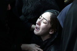 Oct. 4, 2015 - Tehran, iran - Family and friends gather at the Behesht-e Zahra cemetery on October 4, 2015 to say their final farewells to loved ones lost in the Mena tragedy. A total of 465 Iranian pilgrims lost their lives in the large stampede of people at the Hajj rituals on September 24, 2015. The pilgrims were on their way to participate in the symbolic stoning of the Satan in the Mena neighbourhood of Mecca, Saudi Arabia. TEHRAN, IRÃ'N - 04 OCTOBER 2015  (Credit Image: © Rouzbeh Fouladi/NurPhoto via ZUMA Press)