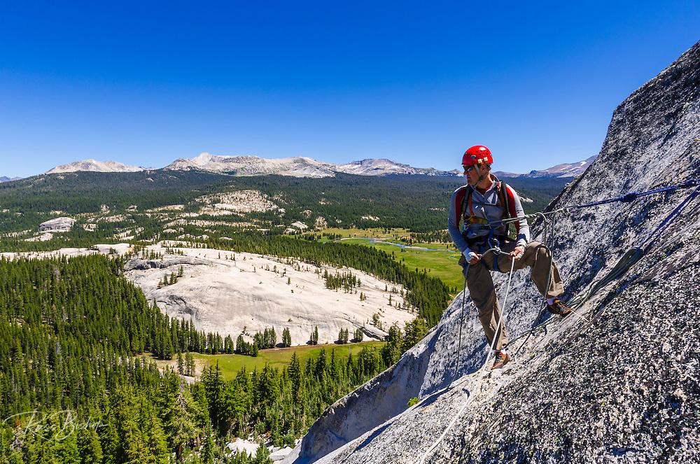 Rock climber on Marmot Dome, Tuolumne Meadows, Yosemite National Park, California USA
