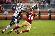 San Francisco 49ers wide receiver Chris Harper (14) catches a pass as New England Patriots cornerback Malcolm Butler (21) tackles him at Levi's Stadium in Santa Clara, Calif., on November 20, 2016. (Stan Olszewski/Special to S.F. Examiner)