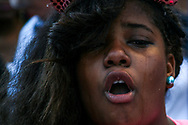 A person cries during a protest against police brutality in Oakland, California, August 20, 2014.