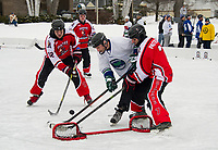 Joe Londer of the Stonedam Islanders goes for a goal in the championship game with Shrinkage on Sunday afternoon at the New England Pond Hockey Classic.  (Karen Bobotas/for the Laconia Daily Sun)