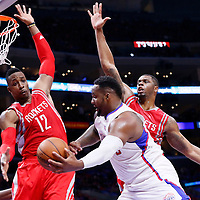 14 May 2015: Los Angeles Clippers forward Glen Davis (0) passes the ball around Houston Rockets forward Terrence Jones (6) and Houston Rockets center Dwight Howard (12) during the Houston Rockets 119-107 victory over the Los Angeles Clippers, in game 6 of the Western Conference semifinals, at the Staples Center, Los Angeles, California, USA.