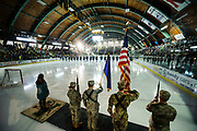 The teams listen to the National Anthem during the men's hockey game between the Mine Black Bears and the Vermont Catamounts at Gutterson Field House on Friday night November 30, 2018 in Burlington. (BRIAN JENKINS/for the FRESS PRESS)