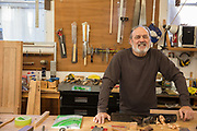 A Mature man in workshop
