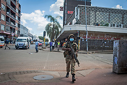 JOHANNESBURG, April 6, 2020  A policeman patrols in a street in Johannesburg, South Africa, April 5, 2020. South Africa imposed a 21-day lockdown from the midnight of March 26 in a bid to stem the spread of coronavirus, known as COVID-19. (Photo by ShiraazXinhua) (Credit Image: © Xinhua via ZUMA Wire)
