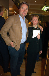NIGEL HAWKINS and HELEN ASPREY at an auction in aid of The Game Conservancy Trust held at Christie's, St.James's London on 12th December 2006.<br />
