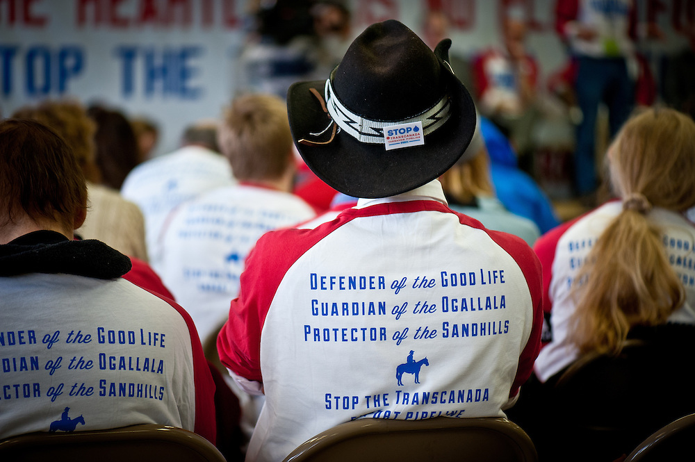 """A pipeline opponent wears a """"Pipeline Fighter"""" t-shirt at a press conference for BOLD Nebraska on the morning of the State Department hearing on the Keystone XL Pipeline Project in Grand Island."""