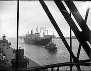 """31/07/1962<br /> 07/31/1962<br /> 31 July 1962<br /> Oil drilling equipment arrives in Dublin. Equipment to be used in the drilling of the 1st exploratory oil well at Rathmolyon, Trim, Co. Meath, arrived in Dublin by ship from Texas. Image shows the Lykes Lines ship """"Kendall Fish"""", arriving at Dublin Port. Tugboat is """"Anna Liffey""""."""