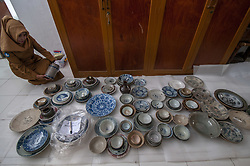 March 26, 2019 - Palu, Central Sulawesi, Indonesia - Palu, Central Sulawesi, Indonesia (March 26): Officers arranged ancient broken ceramics and were reconnected at the Central Sulawesi Museum, Palu, Indonesia, Tuesday, March 26, 2019. About 60 percent of the entire collection of ancient relics in the museum was damaged and broken due to a magnitude 7.4 earthquake that occurred on 28 September 2018 then in the region. (Credit Image: © Basri Marzuki/NurPhoto via ZUMA Press)