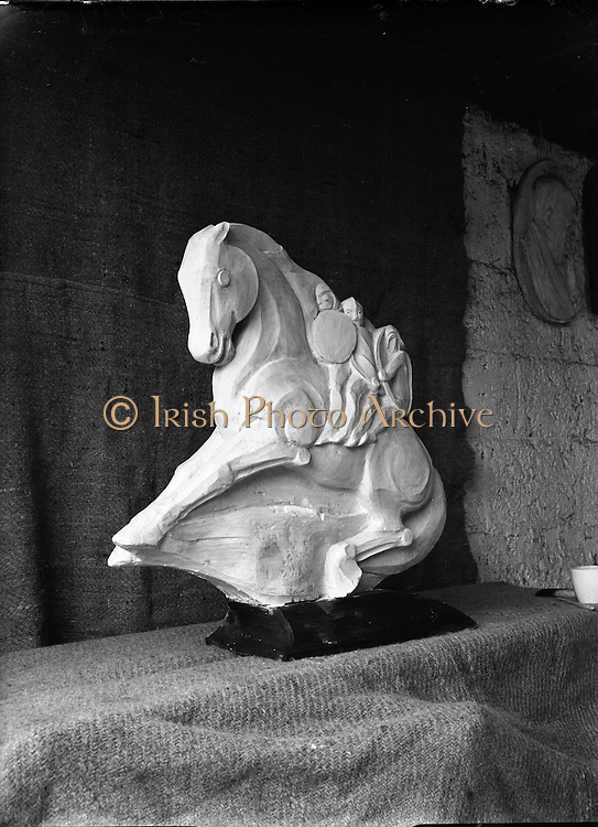 John Haugh - 'Four Sons of Aymon  - Entry for sculptural Competition.22/10/1953..John Haugh was an artist of renown ..Wednesday August 22 2007..The death of Carlingford-based woodcarver John Haugh has left a huge void in the arts scene in North Louth, according to his long-time friend, painter Irene Woods..Mr Haugh, who was in his eighties, had been ill for some time before his death at the weekend, but it is understood that he spent the last day of his life doing what he loved best - carving wood..The renowned wood sculptor, who originally came from Co Clare, was a popular and respected artist in Louth and the wider surrounding area..Perhaps his most famous work, a wood sculpture of John F Kennedy and his family, will shortly be put on display at the County Museum..Mr Haugh got his break as an artist after he carved a stunning Sacred Heart using just a penknife and razorblades. He trained at Glenstall Abbey for a while and then completed his apprenticeship in Belgium just after the end of WWII, before moving back to Ireland..Mr Haugh is survived by his wife Eileen and four children....http://www.argus.ie/news/john-haugh-was-an-artist-of-renown-1072537.html