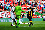 All over - Karl Dryden of Morpeth Town AFC is congratulated by Christopher Swailes of Morpeth Town AFC after the final whistle blows on the FA Vase match between Hereford FC and Morpeth Town at Wembley Stadium, London, England on 22 May 2016. Photo by Mike Sheridan.