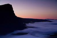 Dawn mist washing at foot of Skierffe mountain, Sarek National Park, Laponia World Heritage Site, Sweden