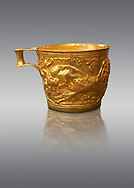 Vapheio type Mycenaean gold cup depicting a wild bull hunt side C , Vapheio Tholos Tomb, Lakonia, Greece. National Archaeological Museum of Athens.  Grey Background<br /> <br /> <br />  Two masterpieces of Creto - Mycenaean gold metalwork were excavated from a tholos tomb near Lakonia in Sparta in 1988. Made in the 15th century BC, the gold cups are heavily influenced by the Minoan style that was predominant in the Agean at the time. The bull hunt was popular with  Mycenaean  and Minoan artists and symolised power and fertility. The distinctive shape of the cup is kown as 'Vapheio type'. .<br /> <br /> If you prefer to buy from our ALAMY PHOTO LIBRARY  Collection visit : https://www.alamy.com/portfolio/paul-williams-funkystock/mycenaean-art-artefacts.html . Type -   Athens    - into the LOWER SEARCH WITHIN GALLERY box. Refine search by adding background colour, place, museum etc<br /> <br /> Visit our MYCENAEN ART PHOTO COLLECTIONS for more photos to download  as wall art prints https://funkystock.photoshelter.com/gallery-collection/Pictures-Images-of-Ancient-Mycenaean-Art-Artefacts-Archaeology-Sites/C0000xRC5WLQcbhQ