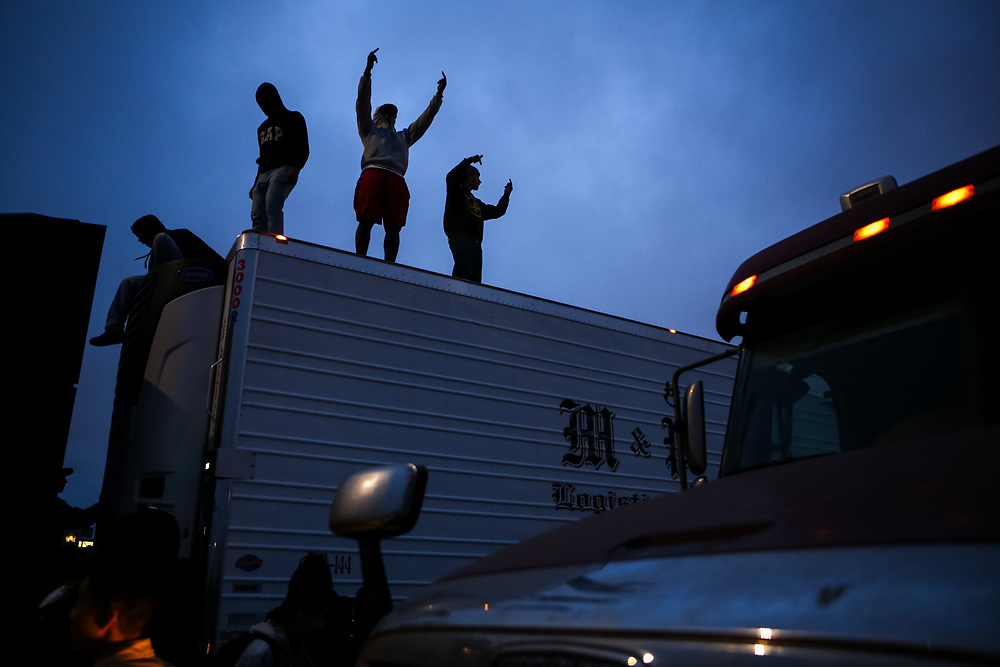Protestors stand on trucks as they occupy both directions of the I-880 freeway following the separate fatal officer-involved shootings of Alton Sterling and Philando Castile, in Oakland, Calif., Thursday, July 7, 2016.<br /> <br /> Sterling was shot by two white Baton Rouge Police Department officers in Baton Rouge, Louisiana and Castile was shot by a St. Anthony police officer in Falcon Heights, Minnesota.