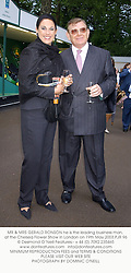 MR & MRS GERALD RONSON he is the leading business man, at the Chelsea Flower Show in London on 19th May 2003.PJR 96