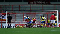 Football - 2020 / 2021 Emirates FA Cup - Round Two: Morecambe vs. Solihull Moors<br /> <br /> Referee Benjamin Speedie looks on from the edge of the area as Tyrone Williams of Solihull Moors gets in a header on goal through a crowd of players, at the Mazuma Stadium.<br /> <br /> COLORSPORT/ALAN MARTIN