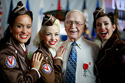 06 June 2014. The National WWII Museum, New Orleans, Lousiana. <br /> Unid'd WW2 veteran with the Victory Belles is honored with the French Legion of Honor medal.<br /> Photo; Charlie Varley/varleypix.com