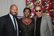 """September 18, 2012- Harlem, New York: (L-R) Emil Wilbekin, Editor-in-Chief, Essence.com, Media Personality Bevy Smith, and Designer Stephen Burroughs at Sylvia's Restaurant 50th Anniversary Golden Jubliee Gala celebrating the life and legacy of the late Sylvia Woods and held at Sylvia's Restaurant on September 18, 2012 in the Village of Harlem, USA. The 50th Anniversary Gala salutes Sylvia's as """"the world's kitchen"""" and celebrates a legend of the historic Harlem community. With an invite-only fundraising event for 500+ guests, the night kicked-off with a lavish cocktail hour and live performances from Sylvia's A-list guests, many of whom have made Sylvia's a home away from home for the past 5 decades. (Terrence Jennings)"""