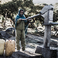 Hafti and waterpump, campground, Simien Mountains, Ethiopia.