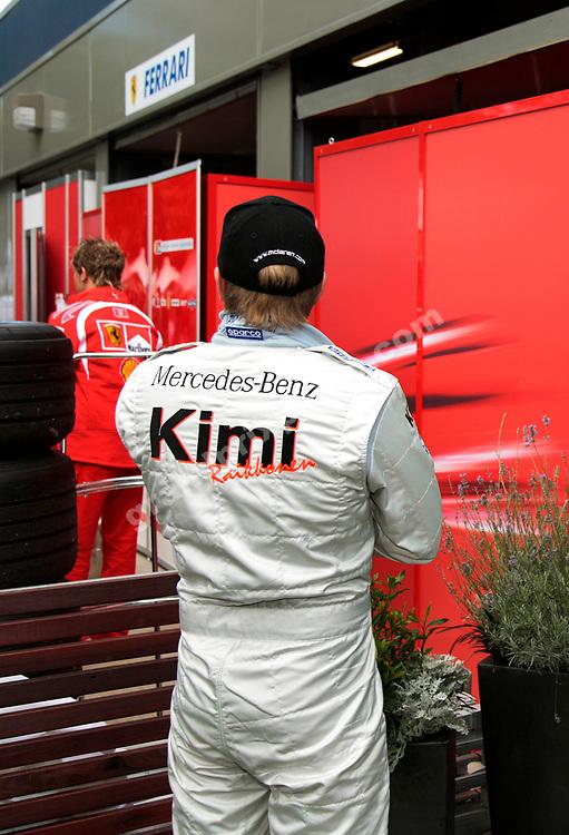 Kimi Raikkonen (McLaren-Mercedes) looking to Ferrari for 2006? Photo from the 2006 Australian Grand Prix in Albert Par, Melbourne. Photo: Grand Prix Photo