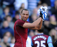 Fotball<br /> England<br /> Foto: Fotosport/Digitalsport<br /> NORWAY ONLY<br /> <br /> Reading v  Aston Villa FA Cup  6th Round 07/03/2010<br /> <br /> Job done - John Carew (Aston Villa) winks to fans as he leaves Madjeski Stadium with Reading shirt