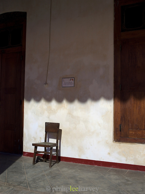 Chair outside an old colonial building at dawn in Galle, Sri Lanka