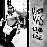"""Translation: """"NO MORE MURDERS FOR THINKING""""<br /> <br /> Buenos Aires, Argentina March 2006<br /> Protest, resistance and memory:  The Stencil images in Buenos Aires. <br /> The stencil art takes the streets of the Argentinian capital. Urban artists bomb in silence the city with messages that combine political and social content, imagination and irony.<br /> Photo: Ezequiel Scagnetti"""