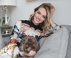"""Lindsay Ellingson releases a photo on Instagram with the following caption: """"Carly\u2019s face here \ud83d\udc3b\u2728 by @1mzoe #carlythecockapoo"""". Photo Credit: Instagram *** No USA Distribution *** For Editorial Use Only *** Not to be Published in Books or Photo Books ***  Please note: Fees charged by the agency are for the agency's services only, and do not, nor are they intended to, convey to the user any ownership of Copyright or License in the material. The agency does not claim any ownership including but not limited to Copyright or License in the attached material. By publishing this material you expressly agree to indemnify and to hold the agency and its directors, shareholders and employees harmless from any loss, claims, damages, demands, expenses (including legal fees), or any causes of action or allegation against the agency arising out of or connected in any way with publication of the material."""