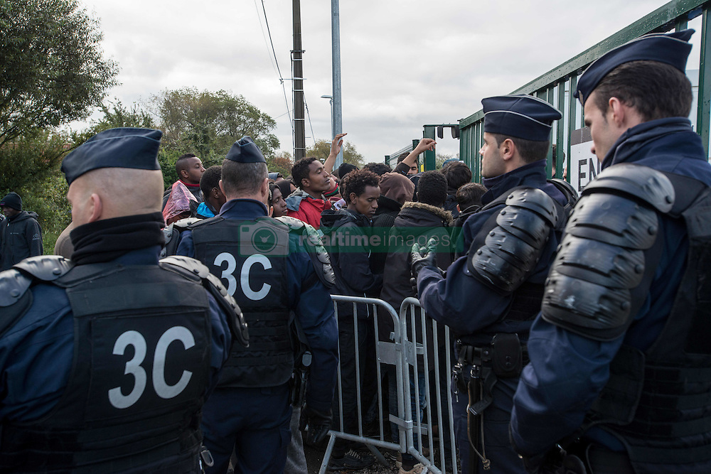October 22, 2016 - Calais, France - A large group of minors queuing in order to do an interview to meep up with a member of their famil who live in the UK. Calais, France, on 22 October 2016.  As the date of the eviction gets closer, the migrants and refugees of jungle are thinking about their options. Some have decided to to leave the camp before the start of the dismantling, others are willing to stay in France and therefore to follow with the plan of entering a center. (Credit Image: © Guillaume Pinon/NurPhoto via ZUMA Press)