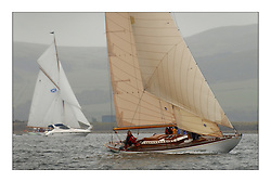 Mikado on the first days racing with Moonbeam surrounded by spectators in the background....This the largest gathering of classic yachts designed by William Fife returned to their birth place on the Clyde to participate in the 2nd Fife Regatta. 22 Yachts from around the world participated in the event which honoured the skills of Yacht Designer Wm Fife, and his yard in Fairlie, Scotland...FAO Picture Desk..Marc Turner / PFM Pictures