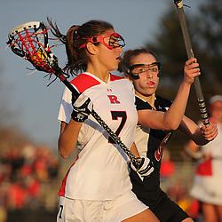 Temple junior midfielder Charlotte Swavola (6) defends Rutgers senior midfielder Ali Steinberg (7). Temple defeated Rutgers 12-11 in NCAA women's college lacrosse at the Rutgers Turf Field in Piscataway, N.J.