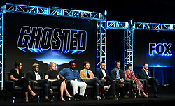 BEVERLY HILLS - AUGUST 8: Cast members Amber Stevens West, Adeel Akhtar, Ally Walker, Executive Producer/cast member Craig Robinson, Executive Producer/cast member Adam Scott, Creator/Writer/Executive Producer Tom Gormican, Creator/Writer/Executive Producer Kevin Etten, Executive Producer Naomi Scott and Executive Producer Mark Schulman onstage during the panel for 'Ghosted' at the FOX portion of the 2017 Summer TCA press tour at the Beverly Hilton on August 8, 2017 in Beverly Hills, California. (Photo by Frank Micelotta/Fox/PictureGroup) *** Please Use Credit from Credit Field ***