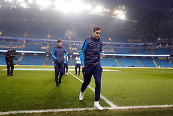 """Tottenham Hotspur's Harry Winks checks out the pitch before the Premier League match at the Etihad Stadium, Manchester. PRESS ASSOCIATION Photo. Picture date: Saturday December 16, 2017. See PA story SOCCER Man City. Photo credit should read: Martin Rickett/PA Wire. RESTRICTIONS: EDITORIAL USE ONLY No use with unauthorised audio, video, data, fixture lists, club/league logos or """"live"""" services. Online in-match use limited to 75 images, no video emulation. No use in betting, games or single club/league/player publications."""