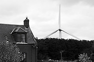 Wind Turbine Near House. Drone Wind Farm, Scottish Borders.