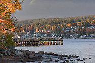 Sunset on a fall day at Rocky Point Park in Port Moody, British Columbia, Canada.  Rocky Point Park has a popular recreational pier, boat launch, outdoor pool, and hiking trails.