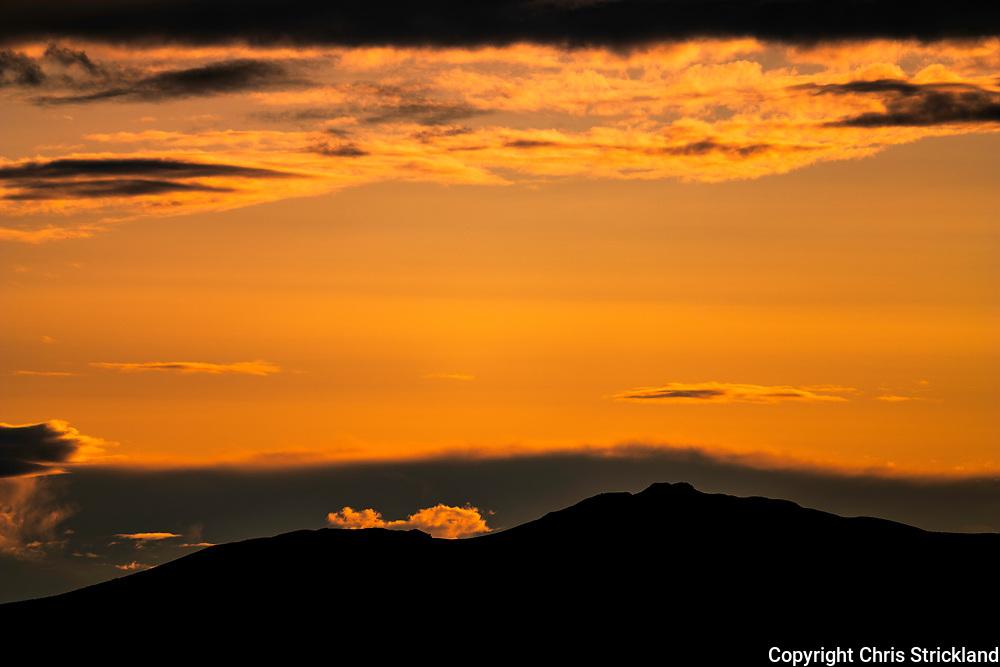 Denholm, Hawick, Scottish Borders, UK. 6th September 2018. The Borders landmark of Ruberslaw is silhouetted at sunset.