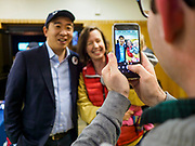 28 APRIL 2019 - DES MOINES, IOWA: ANDREW YANG poses for pictures with a woman and her baby before a Town Hall event in Des Moines. Yang, an entrepreneur, is one of 20 Democrats running for the Democratic nomination for the US Presidency in 2020. Iowa hosts the the first election event of the presidential election cycle. The Iowa Caucuses will be on Feb. 3, 2020.                PHOTO BY JACK KURTZ