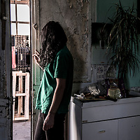"""Elena is 33 years old. """"My former boss raped me for two years. I lived in a shack far away from Vittoria town centre. I was abused in the night. He showed me a gun. If I refused to have sex with him, he wouldn't give me drinking water for my children and they would have to drink water containing herbicide"""". Elena had no car and her abuser took her two children to school every morning; he was an over 60 years old married man with two sons. """"One day, helped by a friend, I quit. I reported the rapes and the abuse to the authorities and I was taken to a special place where I couldn't work. After four months, I decided to go back to Vittoria and find a new job. No action was taken against the former boss and he is still free. Now I have a new job and I'm not afraid of him anymore. My friends say that I was brave to do what I did""""."""