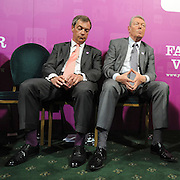 licensed to London News Pictures. LONDON UK. 27/04/11. (L-R)  Nigel Farage and Alan Johnson listen to Caroline lucas' speech. A News conference held today (27 April 2011) in Church House, London. The conference was introduced by Katie Ghose with Lib Dem President Tim Farron, Green Party Leader Caroline Lucas, UKIP leader Nigel Farage and  Labour's  Alan Johnson, supporting a Yes for the Alternative Vote. Photo credit should read Stephen Simpson/LNP