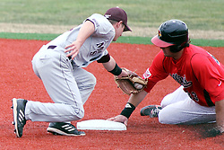 06 April 2013:  Shortstop Travis McCormack mans second base an misses a tag on runner Eric Aguilera sliding in during an NCAA division 1 Missouri Valley Conference (MVC) Baseball game between the Missouri State Bears and the Illinois State Redbirds in Duffy Bass Field, Normal IL