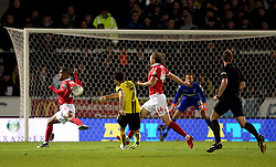 Burton Albion's Scott Fraser scores his side's first goal of the game after a deflection off the back of Nottingham Forest's Saidy Janko (left) during the Carabao Cup, Fourth Round match at the Pirelli Stadium, Burton.