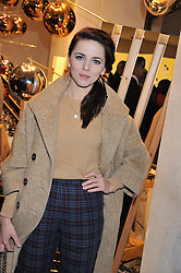 OPHELIA LOVIBOND at a party to celebrate the launch of a limited edition shoe The Chambord in celebration of Nicholas Kirkwood's partnership with Chambord black raspberry liqueur, held at the Nicholas Kirkwood Boutique, 5 Mount Street, London on 12th December 2012.