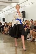 Black skirt with cream and blue top. By Carmen Marc Valvo at the Spring 2013 Fashion Week show in New York.